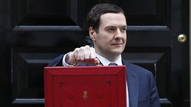 George Osborne, holds his budget case for the cameras