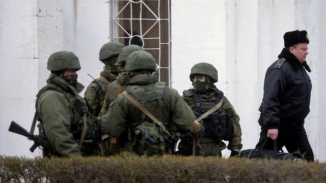 Ukrainian officer leaves base at Novoozerne after it was seized