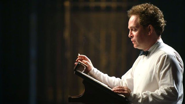 Tom Hollander as