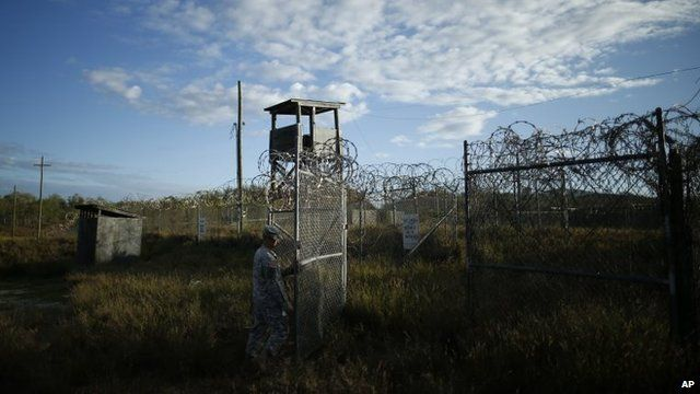 A soldier closes the gate at the now abandoned Camp X-Ray, which was used as the first detention facility at Guantanamo Bay Naval Base, Cuba, November 21, 2013