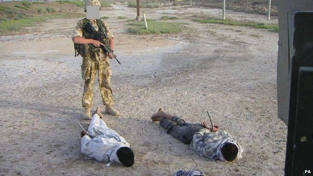 British soldier with detained Iraqis
