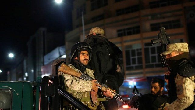 Afghan security personnel arrive near the Serena hotel, during an attack in Kabul March 20, 2014