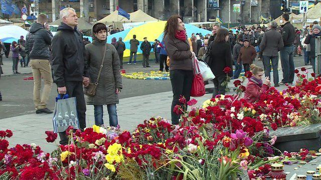 People near flowers