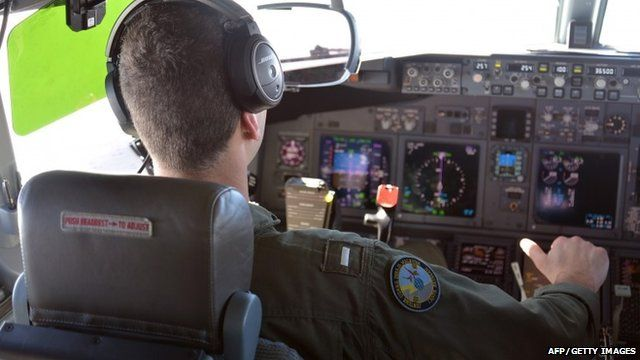 Kyle Atakturk, a naval aviator assigned to Patrol Squadron (VP) 16, piloting a P-8A Poseidon plane in air over the waters of the Indian Ocean