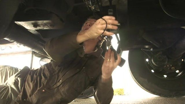 Cameraman installing night-vision camera