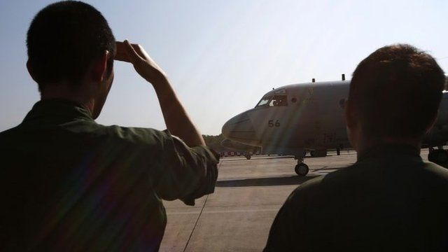Japan Maritime Self-Defence Force personnel prepare to send off two Lockheed P-3C Orion aircrafts to Australia