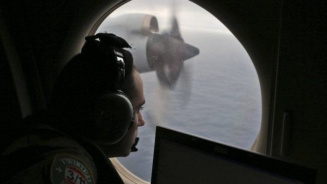 On board a Royal Australian Air Force AP-3C Orion, searching for the missing Malaysia Airlines plane
