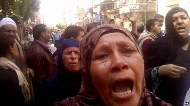 Relatives react after an Egyptian court sentences to death 528 supporters of ousted Islamist President Mohammed Morsi in connection to an attack on a police station that killed a senior police officer in Minya, 24 March 2014