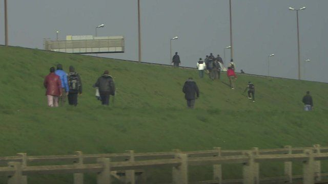 Illegal migrants trying to board UK-bound lorries in Calais