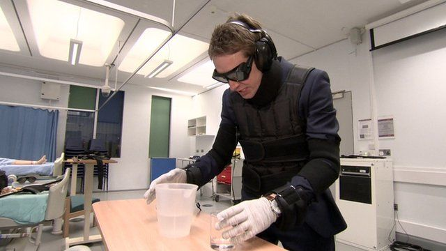 BBC London TV reporter tries on an 'age simulation suit'