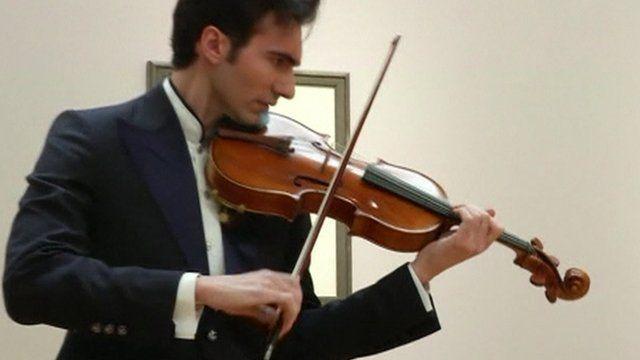 Musician David Aaron Carpenter playing the Stradivarius viola