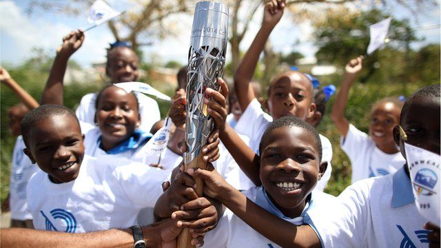 Queen's baton held by children in Barbados