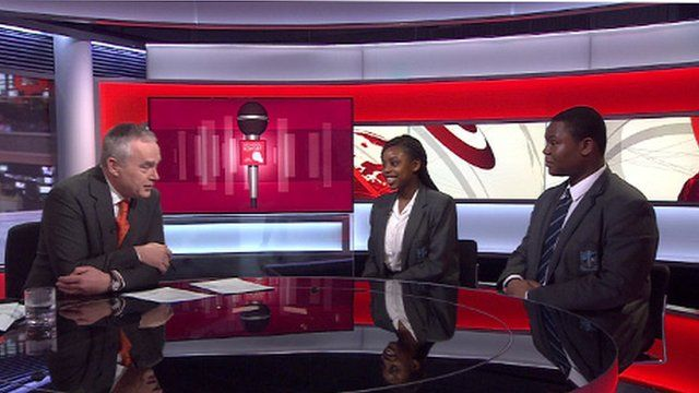 Huw Edwards with pupils Derek and Nicole from St Michael's Catholic College in south London