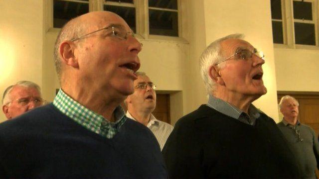 Choir members singing