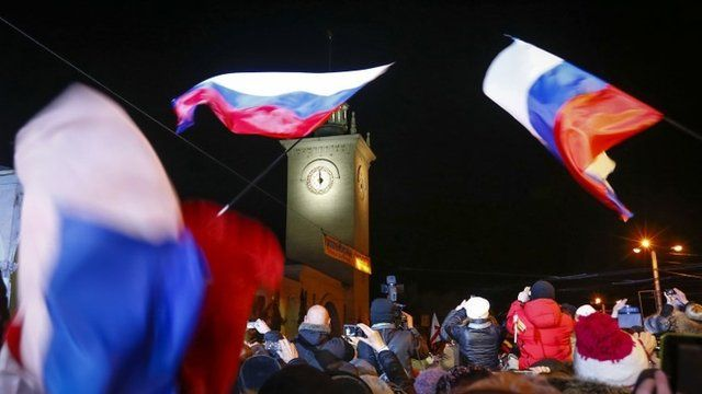 People celebrate the ceremonial change of time on the railway square in the Crimean city of Simferopol