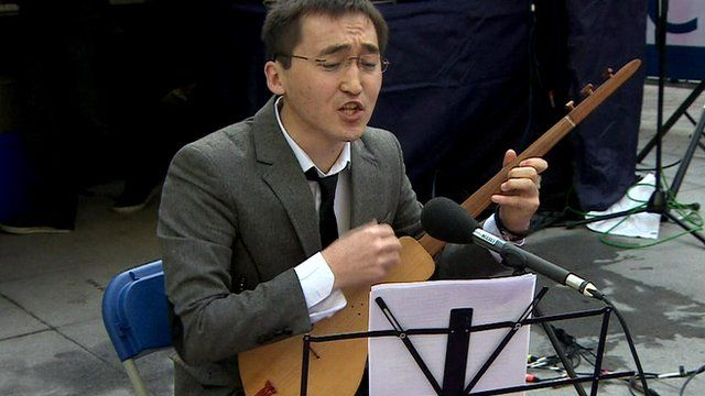 A BBC journalist performing outside the BBC headquarters in London