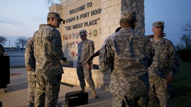 Military personnel wait for a press conference to begin at Ft. Hood, Texas, April 2, 2014
