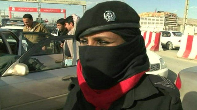An Afghan Police woman at a security checkpoint in Kabul
