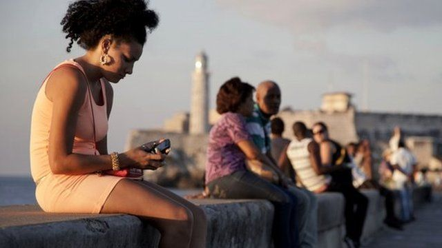 Cuban woman using mobile phone