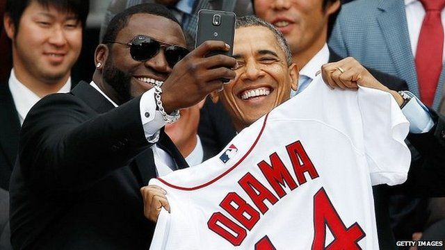 "Boston Red Sox player David Ortiz (left) poses for a ""selfie"" with President Barack Obama"
