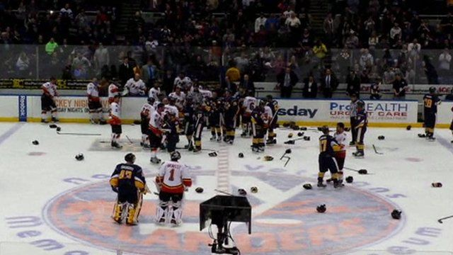 f310be825 NYPD and FDNY brawl at charity ice hockey game - BBC News
