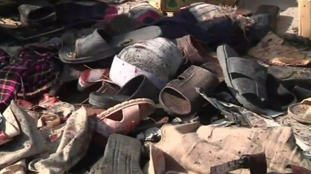 Shoes on rubble of bomb attack in Pakistan