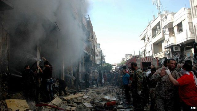 People gathered at the scene of the blasts