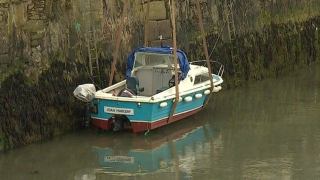 Boat winched into harbour