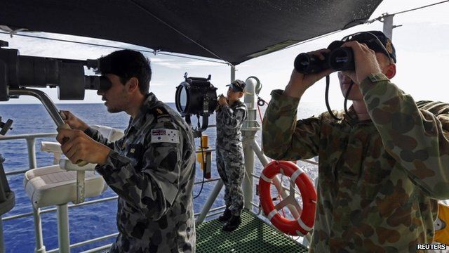 Military personnel on board ship