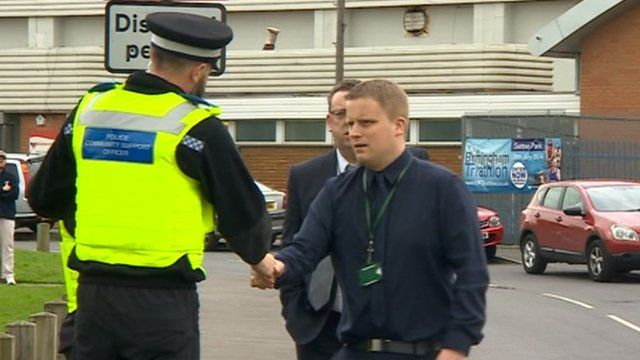 Police and staff outside one of 12 schools under investigation by Birmingham City Council and Ofsted
