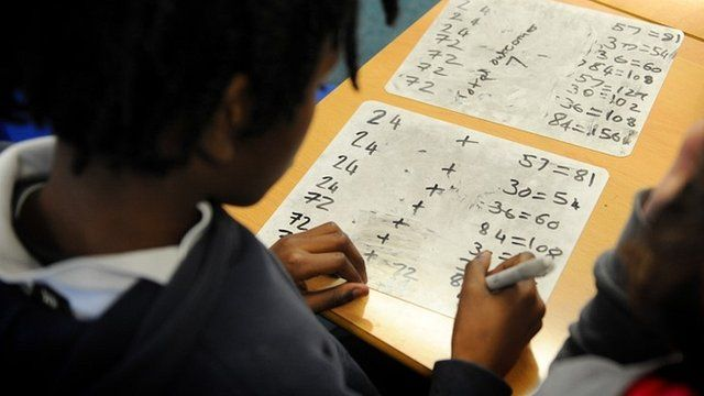 Child doing sums in a classroom