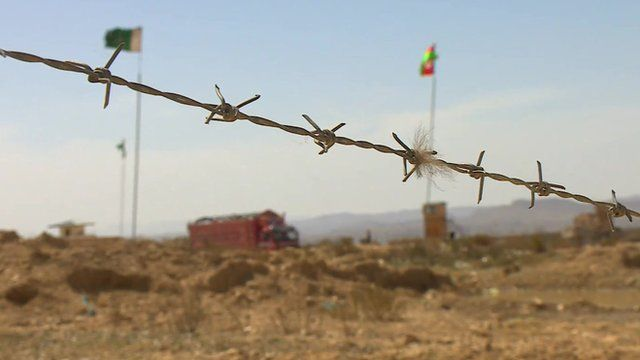 Barbed wire and flags