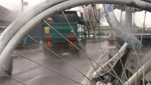 Lorry as seen through spokes of bike