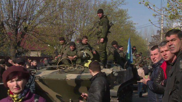 People surround Ukrainian military vehicle