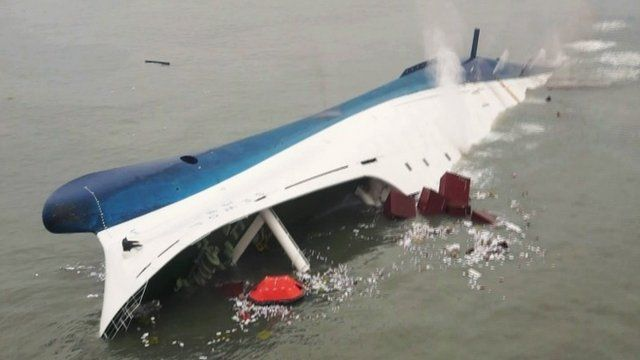 """South Korean ferry """"Sewol"""" is seen sinking in the sea off Jindo April 16, 2014"""