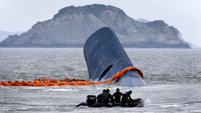 Salvage vessel and the upturned South Korean Sewol ferry