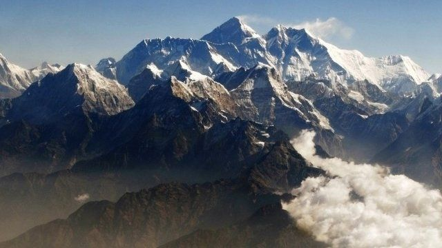 Mount Everest (C), the world's highest peak, and other peaks of the Himalayan range