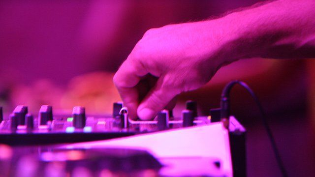 DJ using a mixing desk