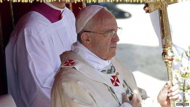 "Pope Francis holds his pastoral cross as he leads the Easter mass in Saint Peter""s Square at the Vatican April 20"