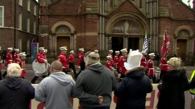 The feeder parade passed St Patrick's Church while residents staged a protest