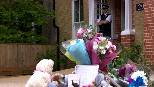 Tributes at house, under police guard
