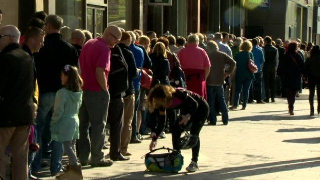 Hundreds of people queued outside the Visit Belfast Welcome Centre for free tickets