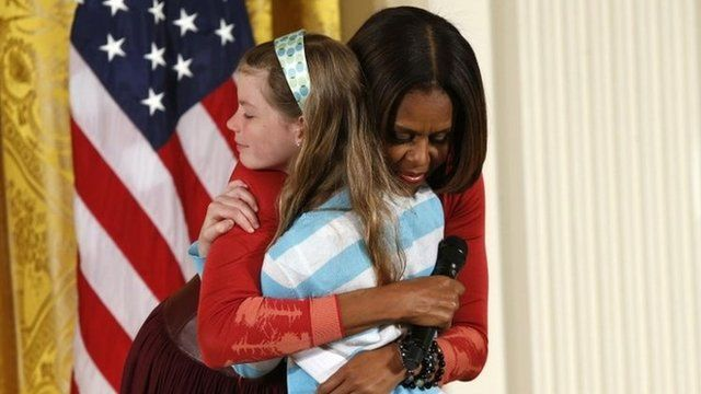 First Lady Michelle Obama hugs Charlotte Bell, at the White House's annual Take Our Daughters and Sons to Work Day 24 April 2014