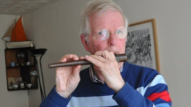 Andrew Fairley with his flute, believed to have been created in the trenches during World War One