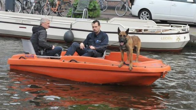 Dutch police and dog on canal