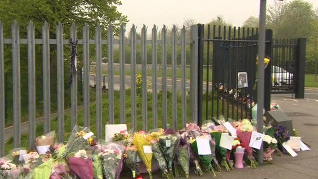 Floral tributes outside the school gates