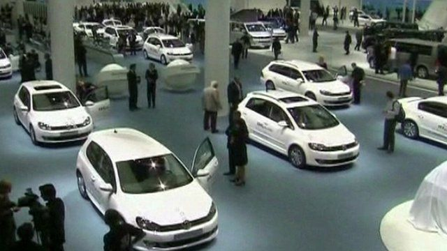 A number of cars on display