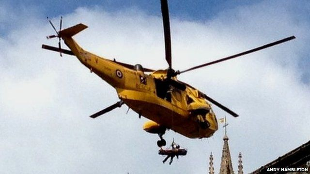 Rescue helicopter above Wells Cathedral