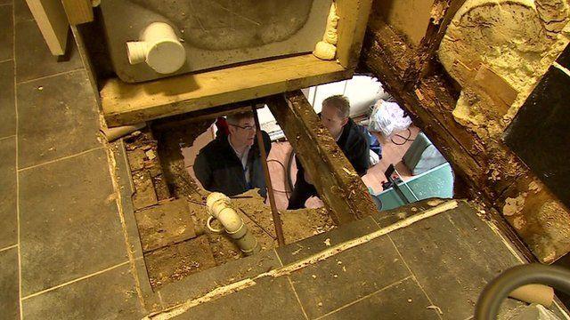 A hole in the floor of a rundown house