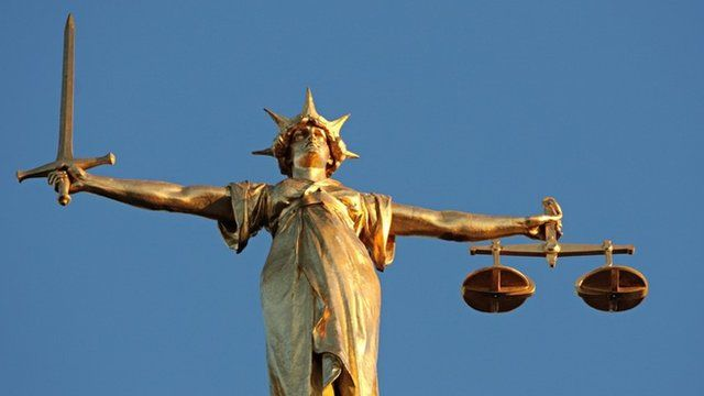 The figure of Lady Justice, at the top of the dome of the Central Criminal Court